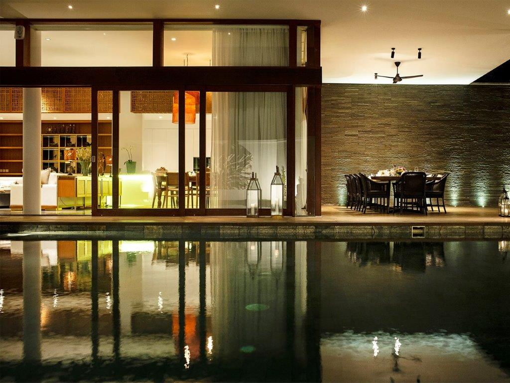 Villa Indrani   Pool and dining area at night